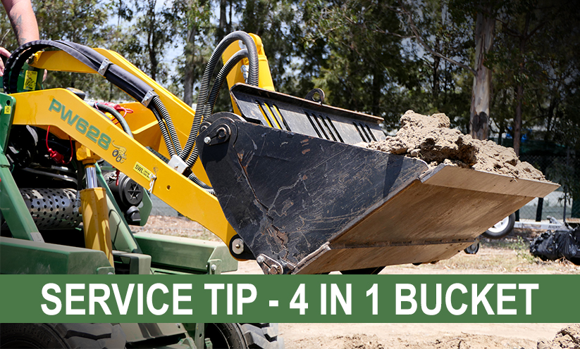 4in1 bucket on a Kanga Compact Loader filled with dirt